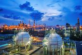 Gas Storage Sphere Tanks And Pipeline In Oil And Gas Refinery Industrial Plant With Glitter Lighting poster