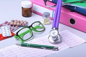 Medical Stethoscope Lying On Cardiogram Chart With Pile Of Pills Closeup. Cardiology Care, Health, P poster