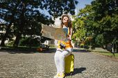 Smiling Traveler Tourist Woman In Casual Clothes, Hat Sitting On Suitcase Holding City Map Search Ro poster