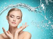 Beautiful Woman With Splashes Of Water In Her Hands. Beautiful Girl Under Splash Of Water With Fresh poster