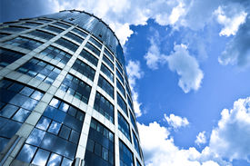 stock photo of building exterior  - Blue modern office skyscraper on sky - JPG