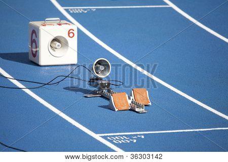 Start Block Of Sprinters And Loudspeaker