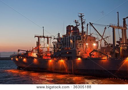 Navy Ship At Night