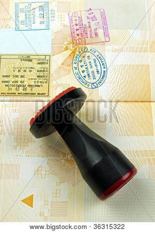 rubber stamp and passport pages