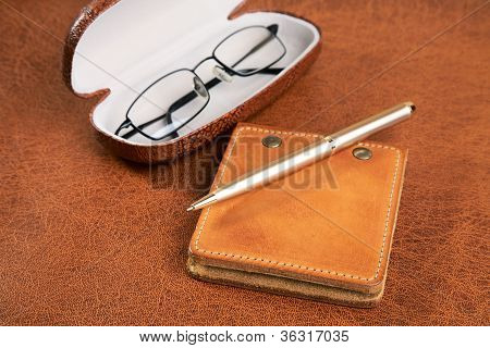 Business  Still-life With A Pen And Glasses