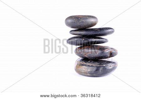 black zen stones on white backgroundt soft shadows