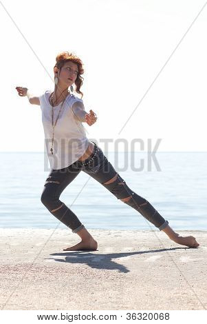 Young Balerina Dancing On The Beach