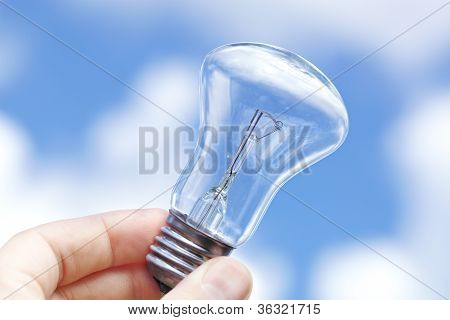 Incandescent lamp against the blue sky