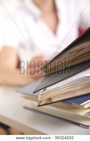 businesswoman with file folder in the office