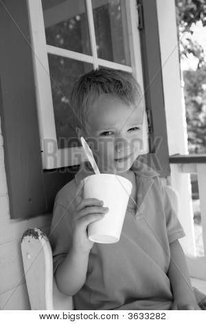 Boy Drinking With Straw
