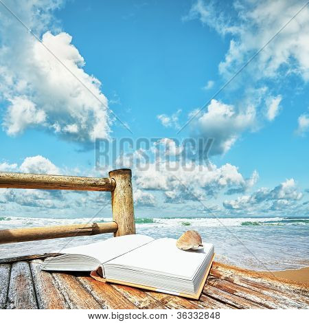 Book With A Seashell On The Bamboo Chair