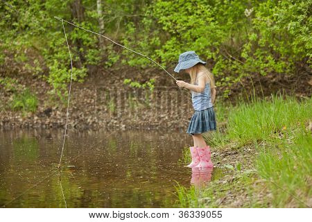 Little Girl Are Fishing On Lake In Forest