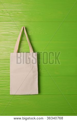 clothes bag on green background concept for save nature reused bag