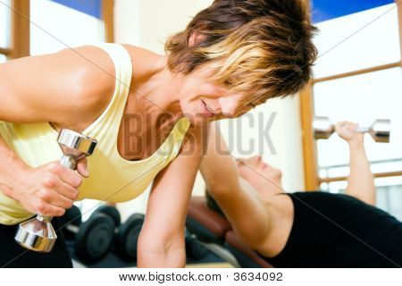People Lifting Dumbbells