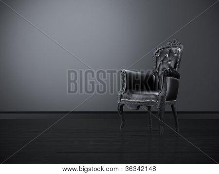 Vintage black chair in the dark room