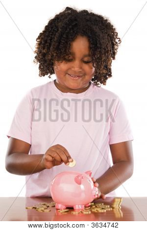 Adorable African Girl Putting A Coin In A Piggbank
