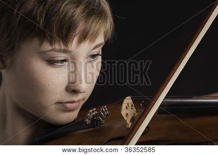 Slight Smile On Teenage Girl Violinist