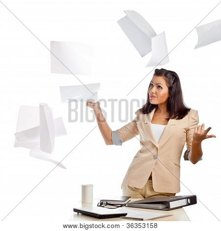 woman throwing up papers