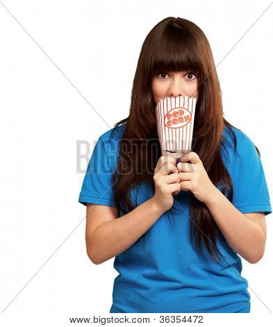 girl looking through empty popcorn packet isolated on white background