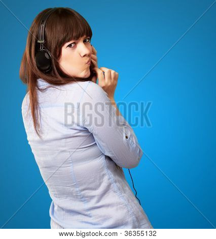 Woman With Headphones And Pouted Lips Isolated On Blue Background