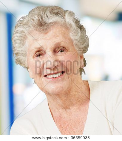 portrait of senior woman smiling against an abstract background