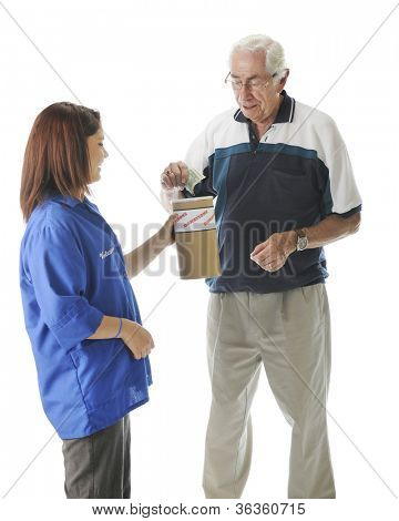 A senior man putting bills into a donation can held by a teen volunteer.  On a white background.