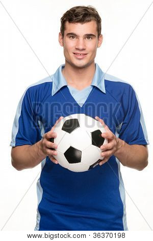 Young soccer player with ball in front of white background