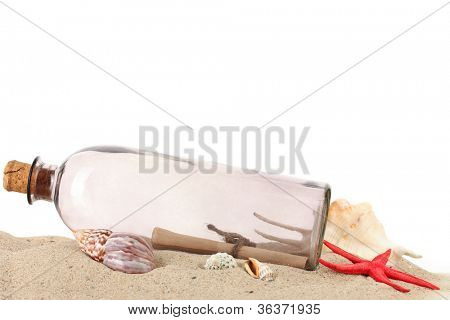 Glass bottle with note inside on sand isolated on white