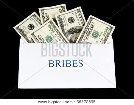 The envelope with the money bills isolated on black. Bribes.