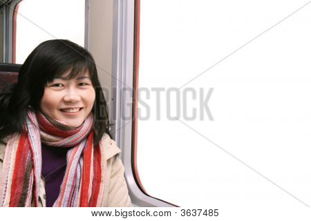 Smiling Asian Girl By Window