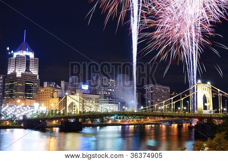Fireworks on the Allegheny river in downtown  Pittsburgh, Pennsylvania, USA.