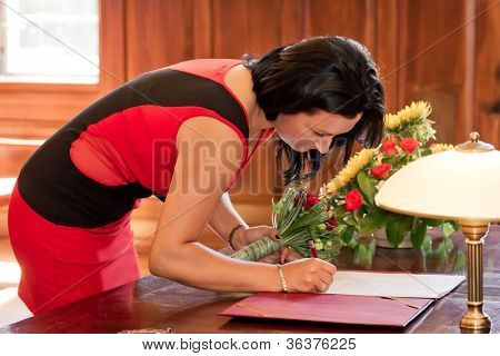 Witness signing marriage form