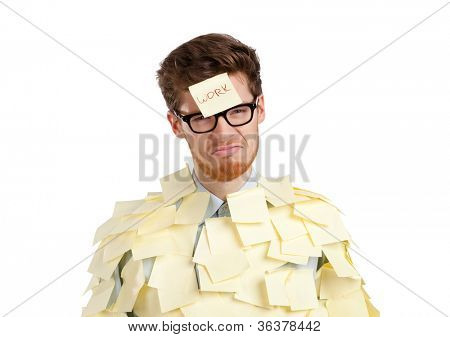 Young man with a sticky note on his face, covered with yellow sticky notes, isolated on white background on white