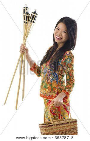 Happy young Malay woman ready to celebrate Hari Raya Aidilfitri / Eid ul-Fitr