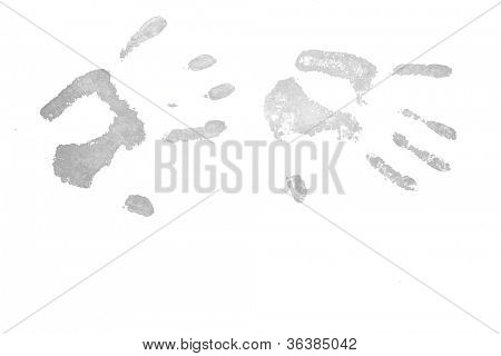 Two grey hand prints against a white background