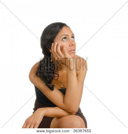 A girl holding her head. Isolated on white. Body language. Boredom. Tedium.