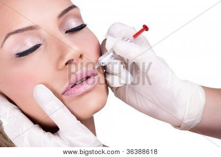 Woman gets cosmetic injection of botox. Beauty Treatment
