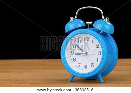 alarm clock watch  on wood background