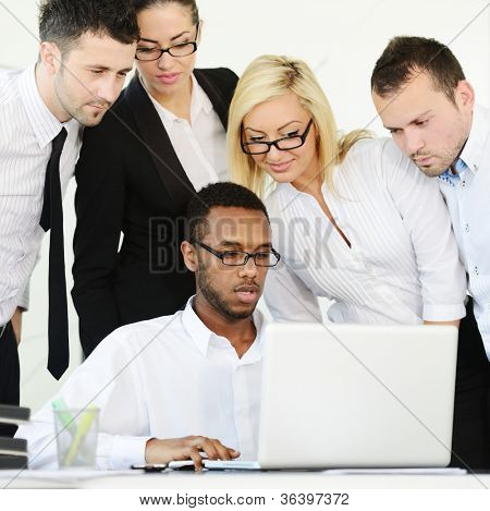 Business group colleagues discussing a project on laptop