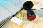 foto of citizenship  - various passport pages with a customs stamping tool - JPG