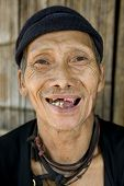 stock photo of bad teeth  - laughing old man with bad teeth Laos in a Hmongdorf - JPG