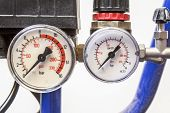 picture of vacuum pump  - industrial barometer in blue air compressorswhite background - JPG