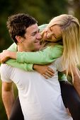 foto of kissing couple  - A young couple outside in the countryside - JPG