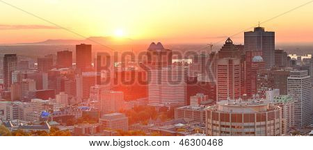 Montreal sunrise panorama viewed from Mont Royal with city skyline in the morning