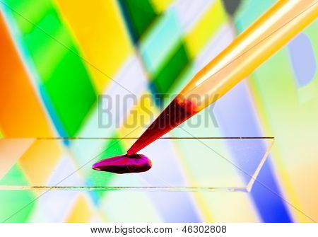 Application of liquid on a microscope slide