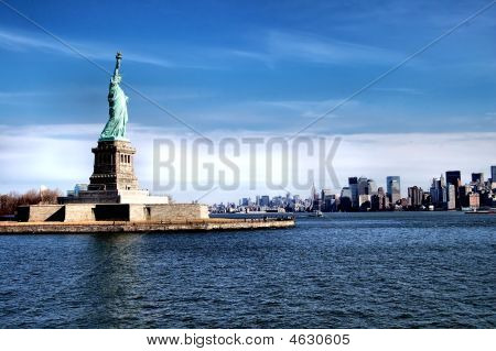 The Statue Of Liberty And Manhattan