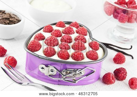 Small raspberry tart in a heart shaped spring form