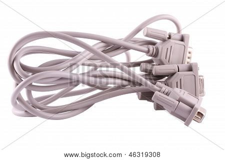 Two Com Wires Tangled Behind On A White Background