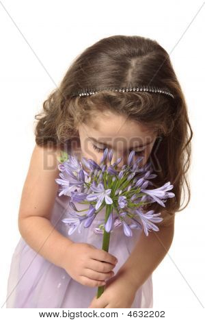 Young Girl Sniffing Flower