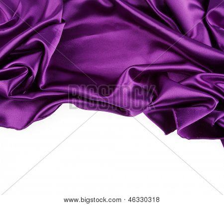 Closeup of purple silk fabric on white background